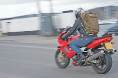 Motor bike blur. A blurred  image of a new red motorbike passing over a bridge across the Caledonian Canal in Inverness Royalty Free Stock Photo