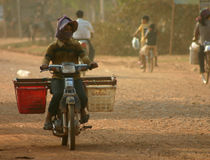 Motor Bike, Cambodia. Lady riding motor bike in rural Cambodia Stock Images