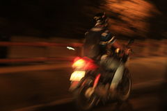 Motor bike in motion at night Stock Photography