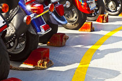 Motor bikes with break shoe at. A ferry in a row Stock Image