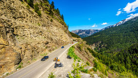 Motor Bikes and Fast Cars driving Highway 99, also called The Duffey Lake Road. As it winds its way through the Coast Mountain Range between Pemberton and Royalty Free Stock Image