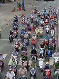 Motor bikes in Ho Chi Minh City. Many motorbikes lining up for the traffic lights in Ho Chi Minh city.  Pollution Stock Images