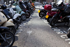 Motor bikes parked in a row  Royalty Free Stock Photos