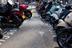 Motor bikes parked in a row Royalty Free Stock Photo