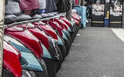 Motor bikes are seats in Camden market  London.  Stock Photography