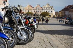Motor Bikes on Square. Motor bikes parked on square, Telc, Czech Republic, buildings and people in background Stock Photo