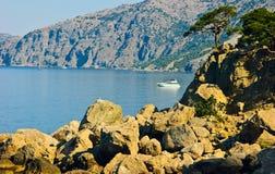 Motor boat. Rocks and trees Stock Photos
