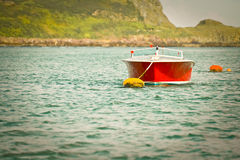 Motor boat. Retro styled motor boat moored on water Royalty Free Stock Images