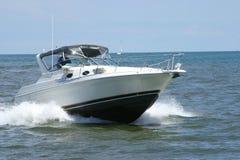 Motor boat. A motor boat speeding across the lake Royalty Free Stock Photos