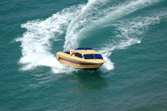 Motor boat. Making a turn in the sea Royalty Free Stock Image