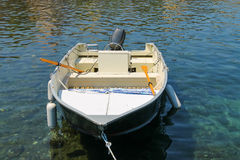 Motor boat anchored in the small port on Elba Island, Italy. Stock Images
