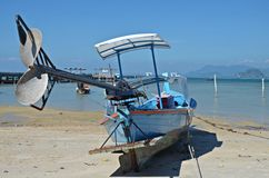 Motor boat on the beach. On ko mook islant, thailand Stock Photography