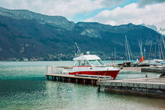 Motor boat of a coast guard parked in Annecy, France Stock Photos