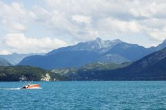 A motor boat crosses the lake Annecy Royalty Free Stock Photography