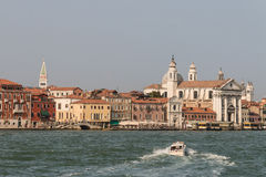 Motor boat crossing Grand canal in Venice Royalty Free Stock Photography