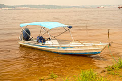 Motor boat on dirty water Stock Images