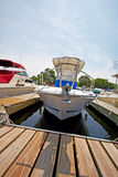 Motor boat docked in the marina. royalty free stock photography