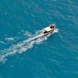 Motor boat driving fast on the blue sea Royalty Free Stock Images