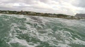 Motor boat entering rough sea on the coast of South Africa stock video