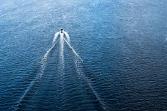 The motor boat floating in the blue Dnieper waters.  Royalty Free Stock Photography
