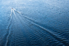 The motor boat floating in the blue Dnieper waters Stock Image