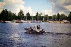 Motor boat floating on Lake Saimaa in the city of Imatra Finland Royalty Free Stock Images