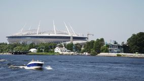Motor boat floating river in city. Stadium. Summer sunny day. Water surface. stock footage