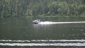 Motor boat floats on the river stock video
