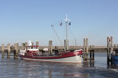 Motor boat in the harbor of Harlingen Royalty Free Stock Photo