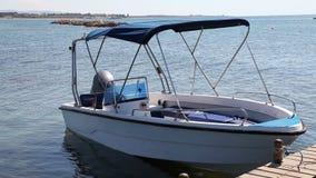 Motor boat on jetty stock video