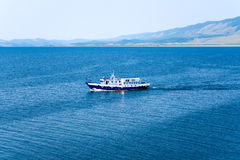 A motor boat on Lake Baikal on a summer morning. Royalty Free Stock Images
