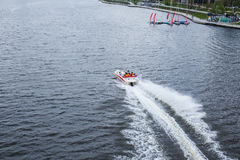 Motor boat on the lake. Patches of passengers at high speed Royalty Free Stock Images
