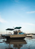 Motor boat with low tide Royalty Free Stock Images