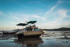 Motor boat with low tide Stock Photography