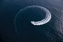 Motor boat making a turn in form of a swirl Royalty Free Stock Photo