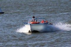 Motor boat. A man sailing motor boat royalty free stock photos