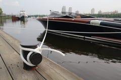 Motor boat and mooring rope closeup Royalty Free Stock Images