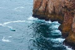 Motor boat near cliff. Royalty Free Stock Photos