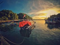 Motor Boat Near Dock during Sunset Royalty Free Stock Photography