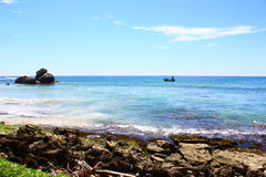 Motor boat near the shore of the Indian ocean Royalty Free Stock Images