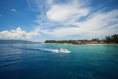 A motor boat in the ocean on a tropical island. A motor boat in the ocean amid a tropical Gili Islands on a clear Sunny day, Indonesia Royalty Free Stock Photography