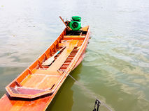 Motor boat parked on the edge of the pond with concrete stair Stock Image