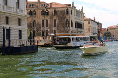 Motor boat with passengers and vaporetto at the stop Samuele Stock Photos
