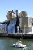 Motor boat past the Guggenheim Museum Royalty Free Stock Photography