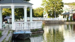 Motor boat at the pier. On the lake in the city park of Nalchik Royalty Free Stock Photography