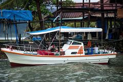 Motor boat at the pier in Tai Stock Photos