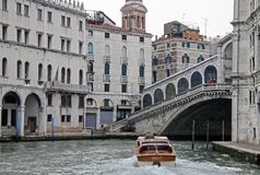 Motor boat at Rialto Bridge on Grand Canal, Venice, Italy Stock Photo