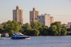 Motor boat on river in city Royalty Free Stock Photos
