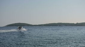 Motor boat sailing on the Adriatic Sea in Croatia stock video