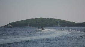 Motor boat sailing on the Adriatic Sea in Croatia stock footage